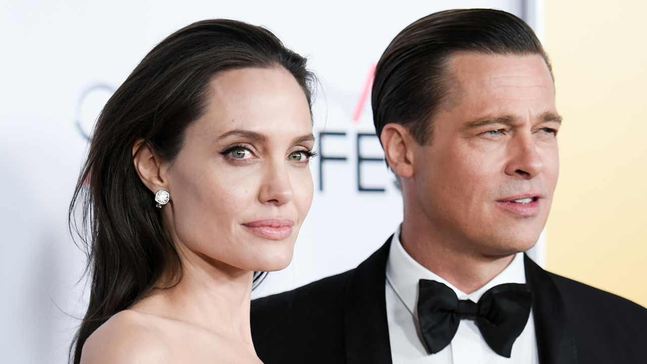 Angelina Jolie, left, and Brad Pitt arrive at the 2015 AFI Fest opening night premiere of By The Sea on Thursday, Nov. 5, 2015, in Los Angeles.