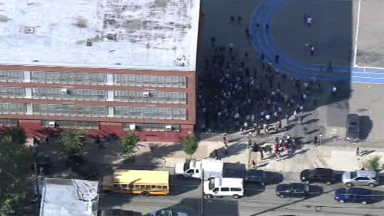A West Philadelphia school was placed on lockdown after a report of an armed suspect inside the school.