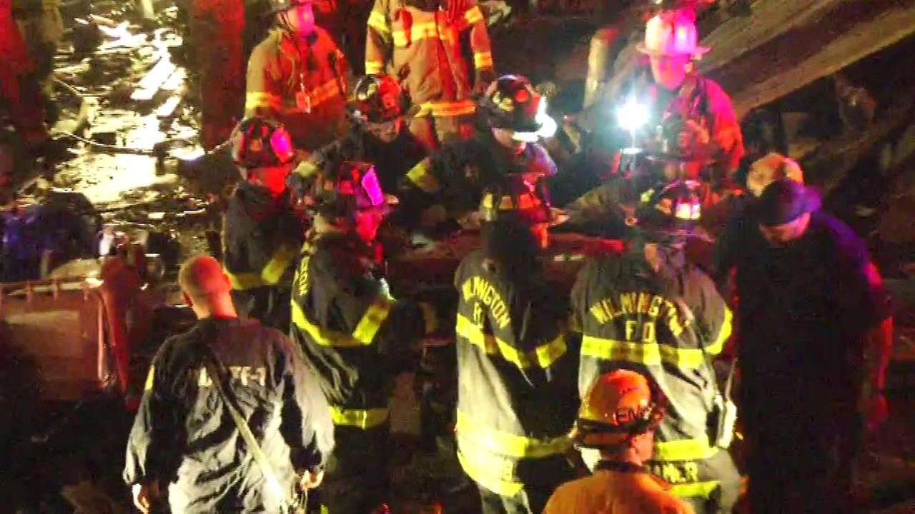 PICTURES: 2 firefighters dead, 1 critically injured in Wilmington house blaze