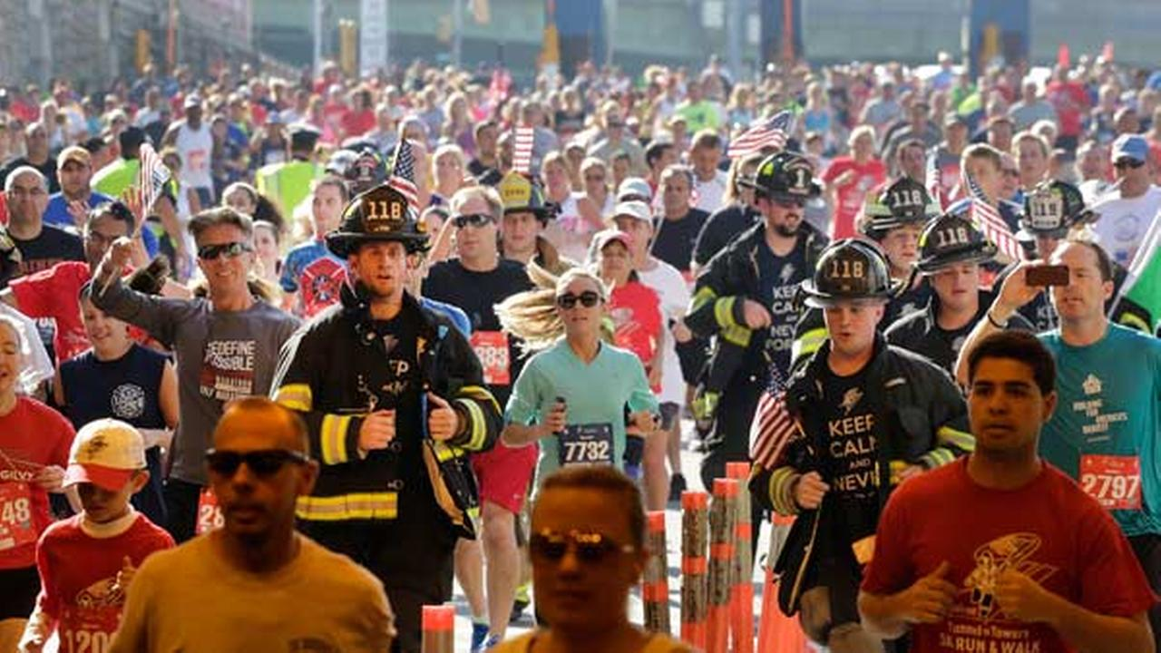 FILE: Firefighters and runners participate in the annual Stephen Siller Tunnel to Towers memorial event, Sunday, Sept. 28, 2014 in the Brooklyn borough of New York.