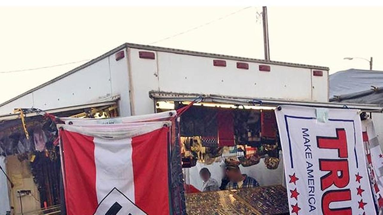 This photo provided by Edward Conner, cropped by 6abc, shows a Nazi flag displayed for purchase on a merchandise vendors trailer, Sept. 24, 2016, at Bloomsburg Fair fairgrounds.