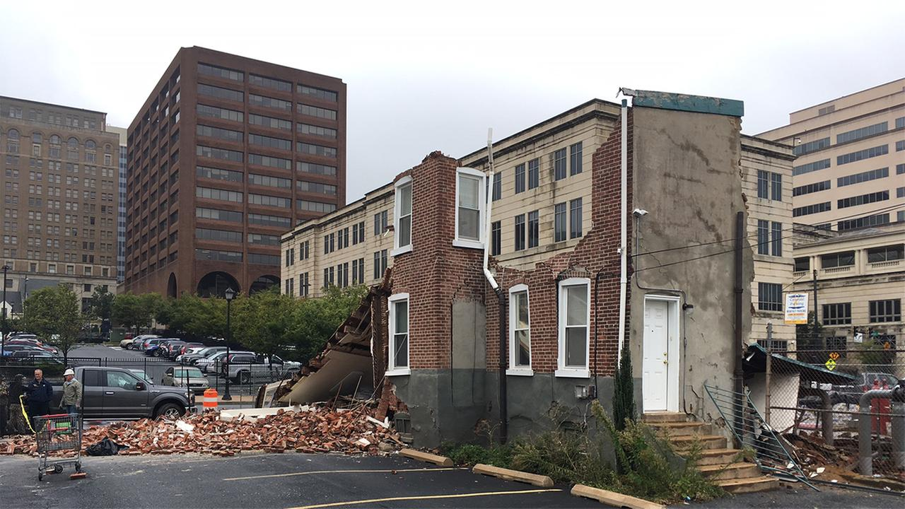 Police and fire officials say heavy rains may have caused a building to collapse in downtown Wilmington, Delaware.