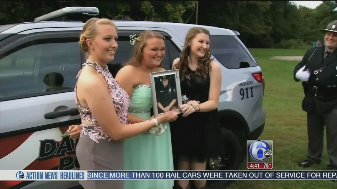 VIDEO: Daughters of fallen Ohio officer get police escort to homecoming dance