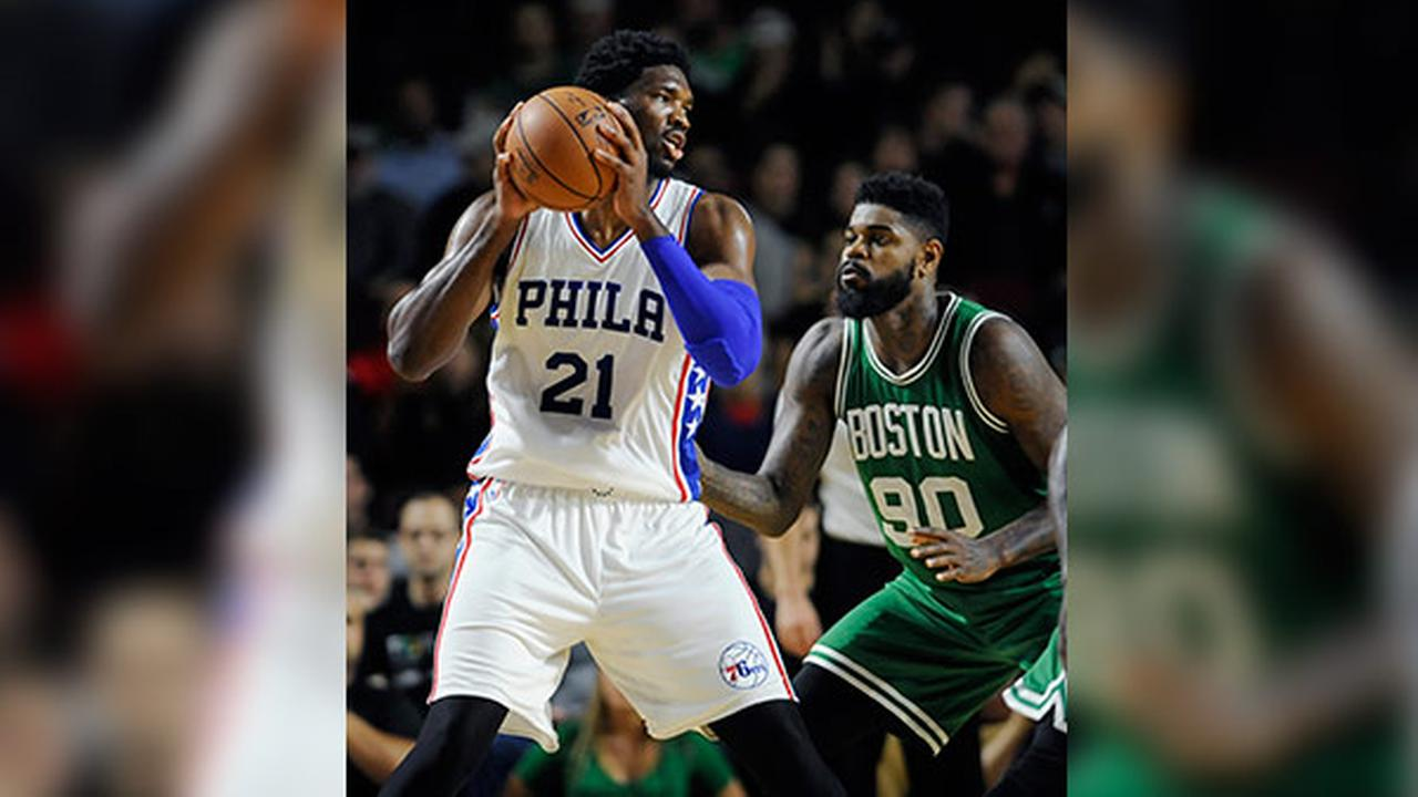 Philadelphia 76ers Joel Embiid is guarded by Boston Celtics Amir Johnson, right, during the first half of an NBA preseason basketball game, Tuesday, Oct. 4, 2016, in Amherst, Mas