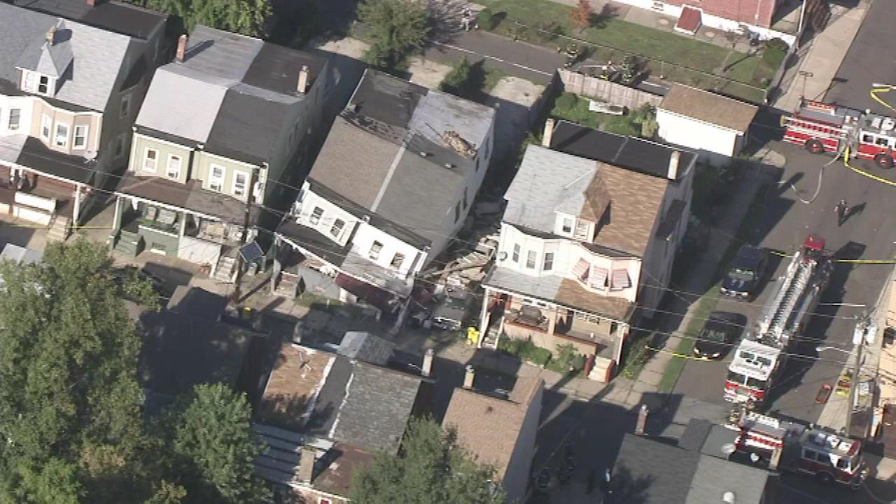 Crews on the scene of a partial house collapse in Trenton, New Jersey.