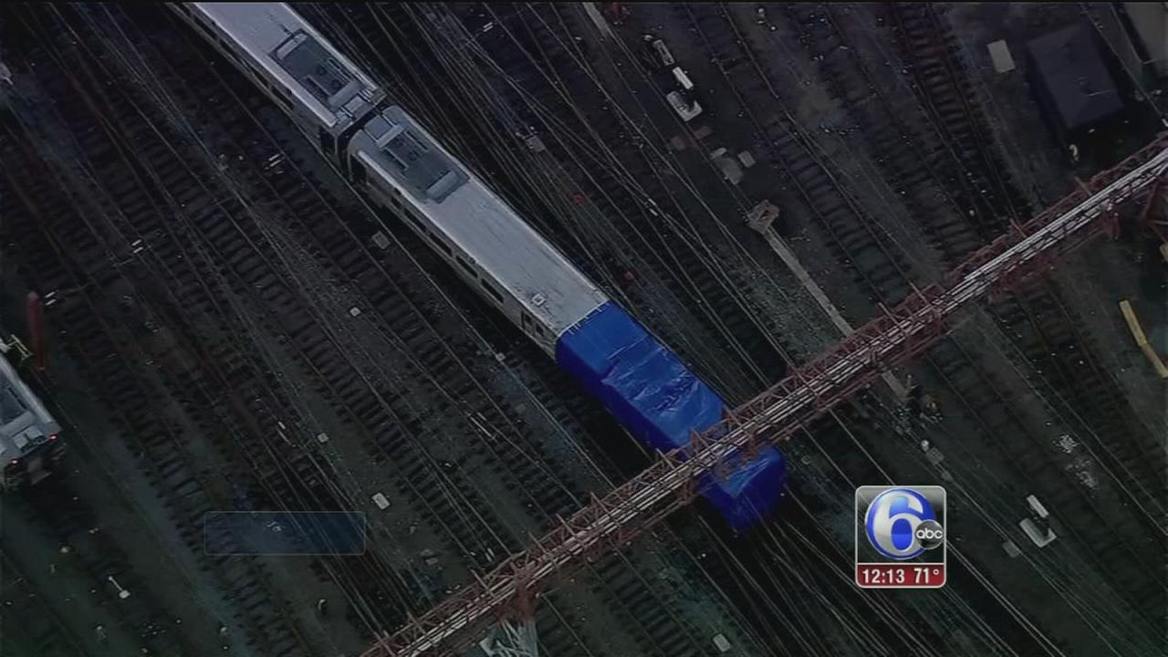 VIDEO: Damaged NJ Transit train removed from terminal after crash