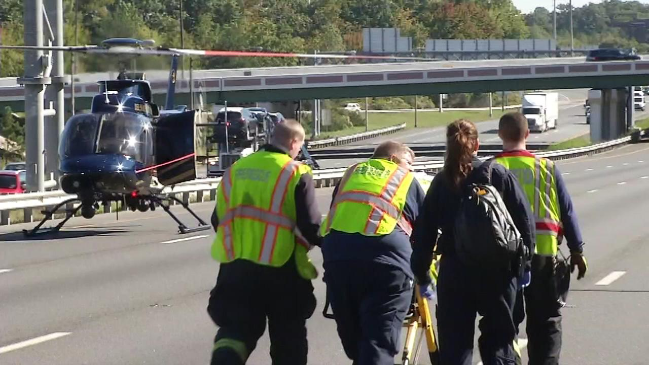 An overturned vehicle shut down two lanes of I-95 in Newark, Delaware late Tuesday morning.