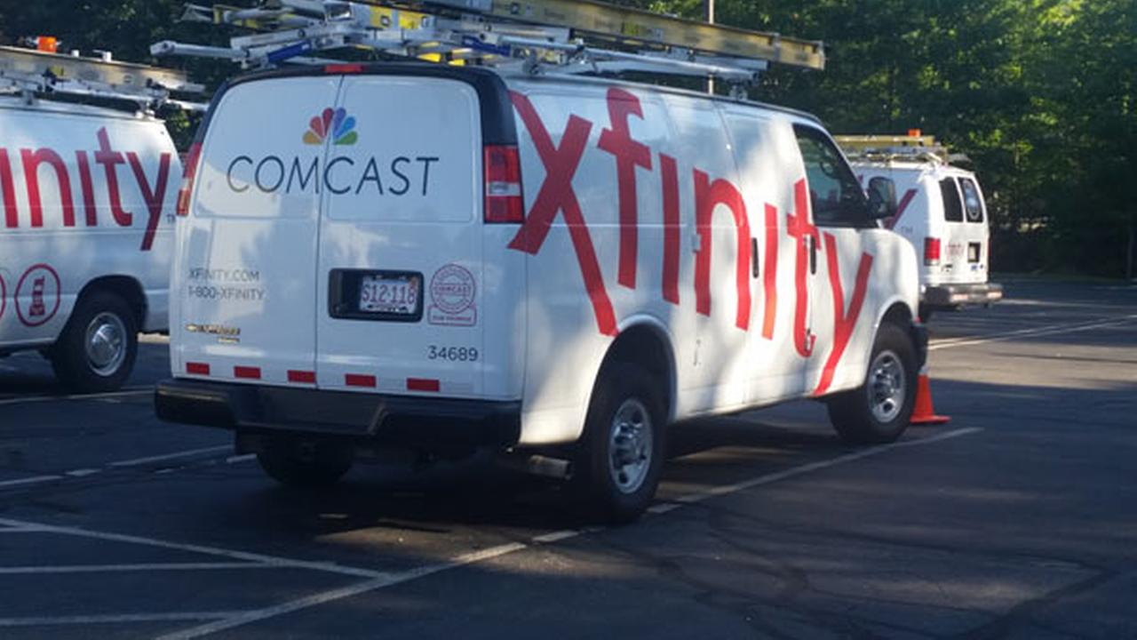 In this Sept. 17, 2015 photo, Comcast trucks are parked in a lot in the companys Westford, Mass. operations center.