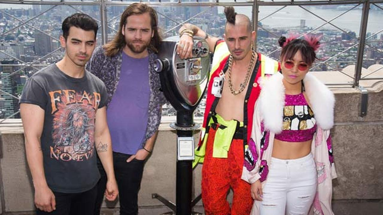 DNCE band members, from left, Joe Jonas, Jack Lawless, Cole Whittle and JinJoo Lee visit the Empire State Building on Wednesday, June 1, 2016, in New York.Photo by Charles Sykes/Invision/AP