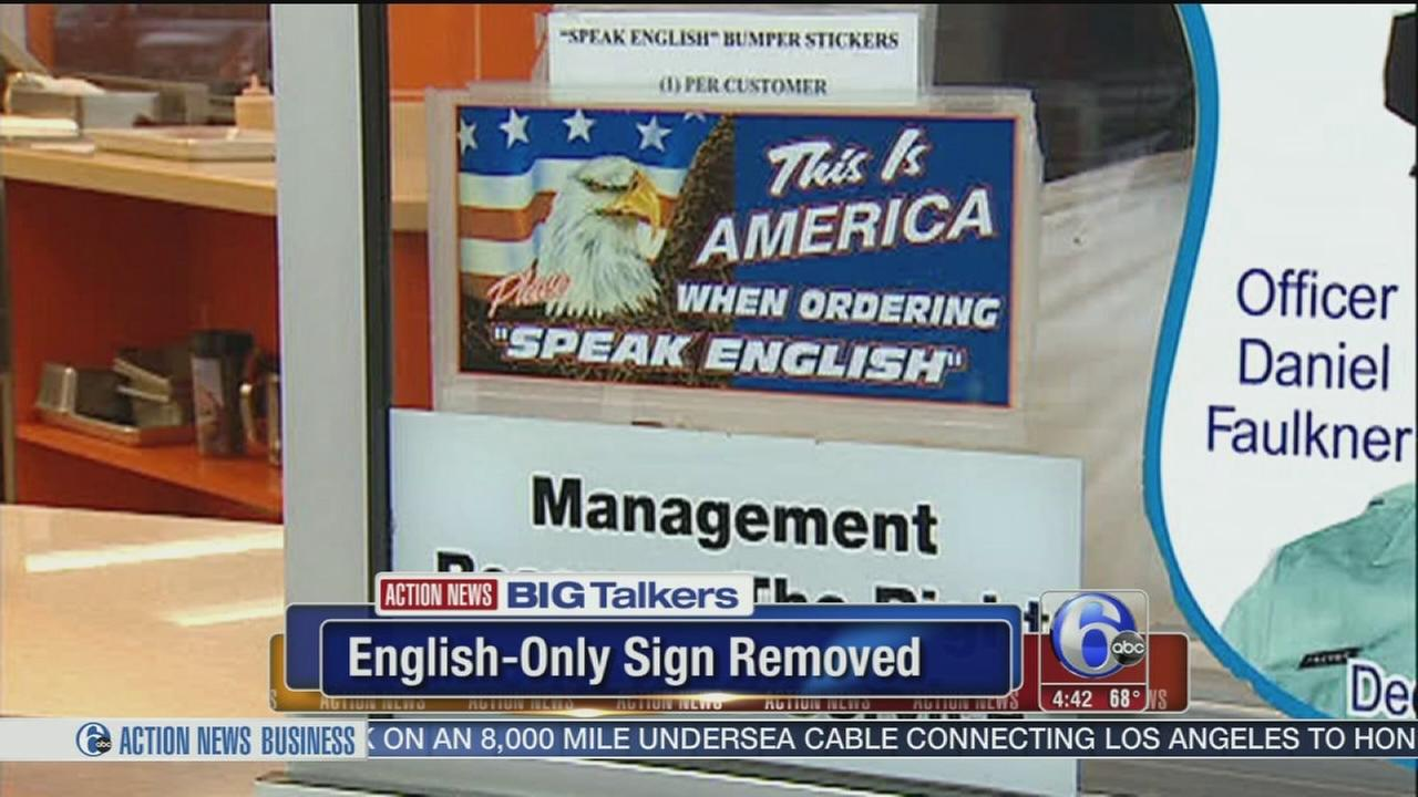 VIDEO: Genos removes controversial speak English sign from window