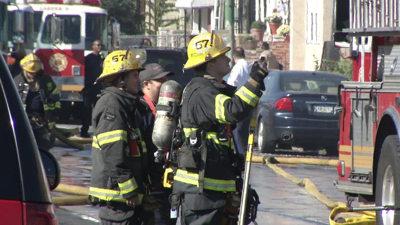 Firefighters battled a blaze on Girard Avenue in West Philadelphia on Saturday.