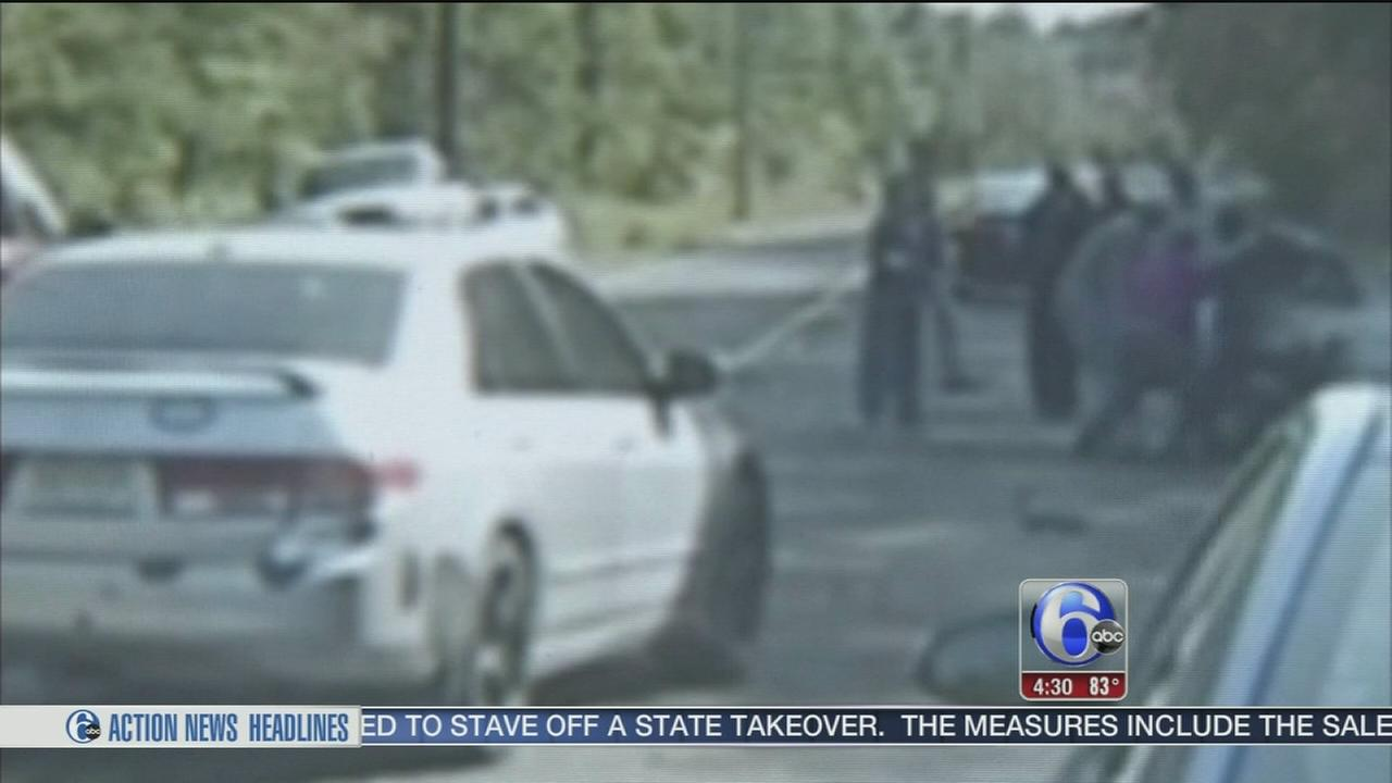 VIDEO: Good Samaritans help woman trapped under car