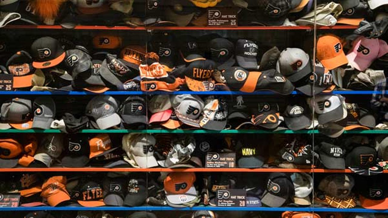 Philadelphia Flyers fans hats, tossed on the ice after a player scored a hat trick, have been collected through the years and are displayed in a case at the Wells Fargo Center.