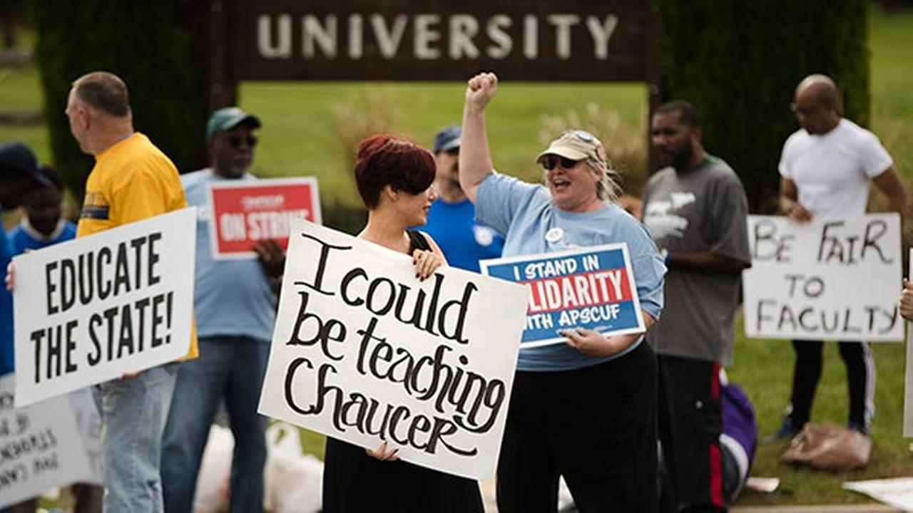 Faculty member Angela Florschuetz, center, her colleagues, and their supporters picket at Cheyney University in Cheyney, Pa., Thursday, Oct. 20, 2016.