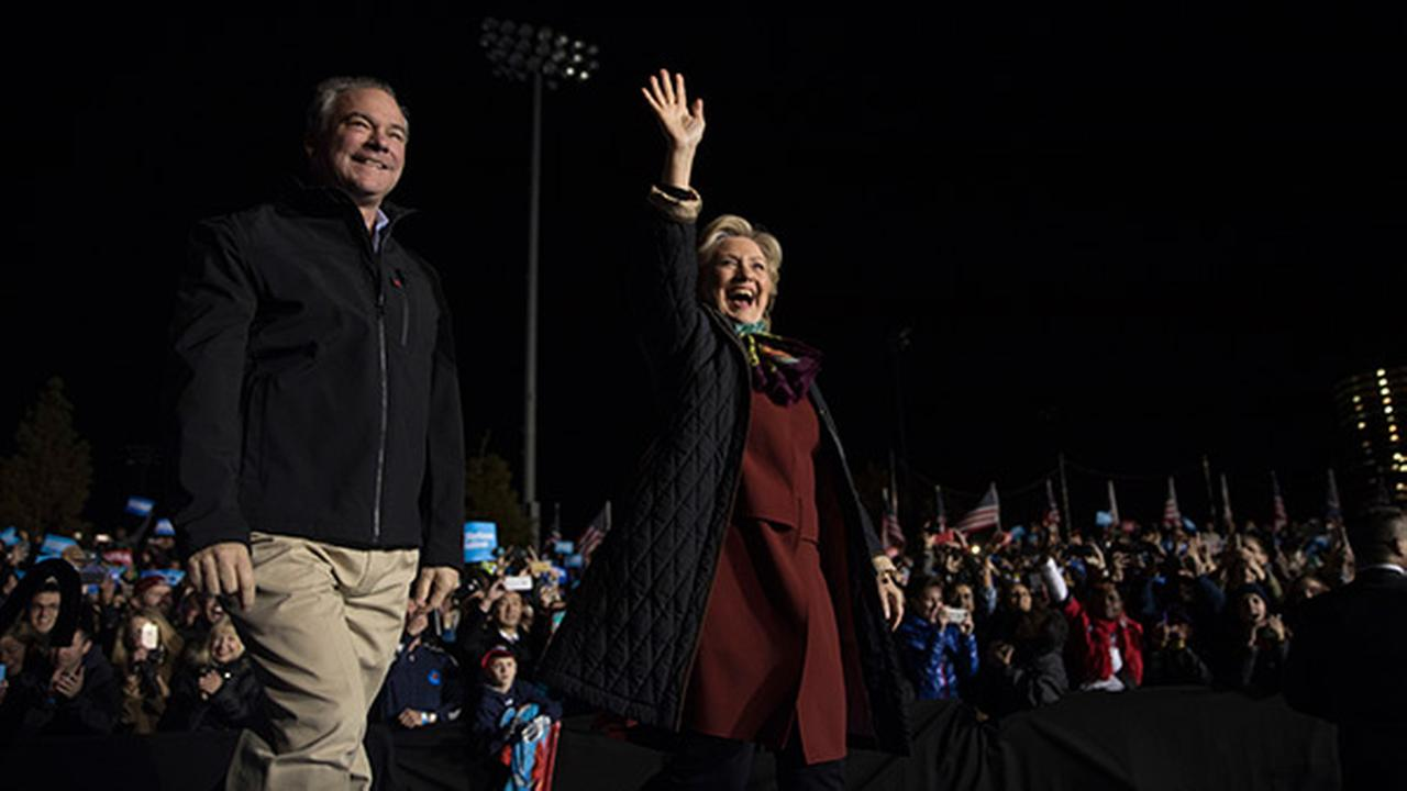 Hillary Clinton and Sen. Tim Kaine, D-Va. arrive at a campaign event at Dunning-Cohen Champions Field, Saturday, Oct. 22, 2016, in Philadelphia.