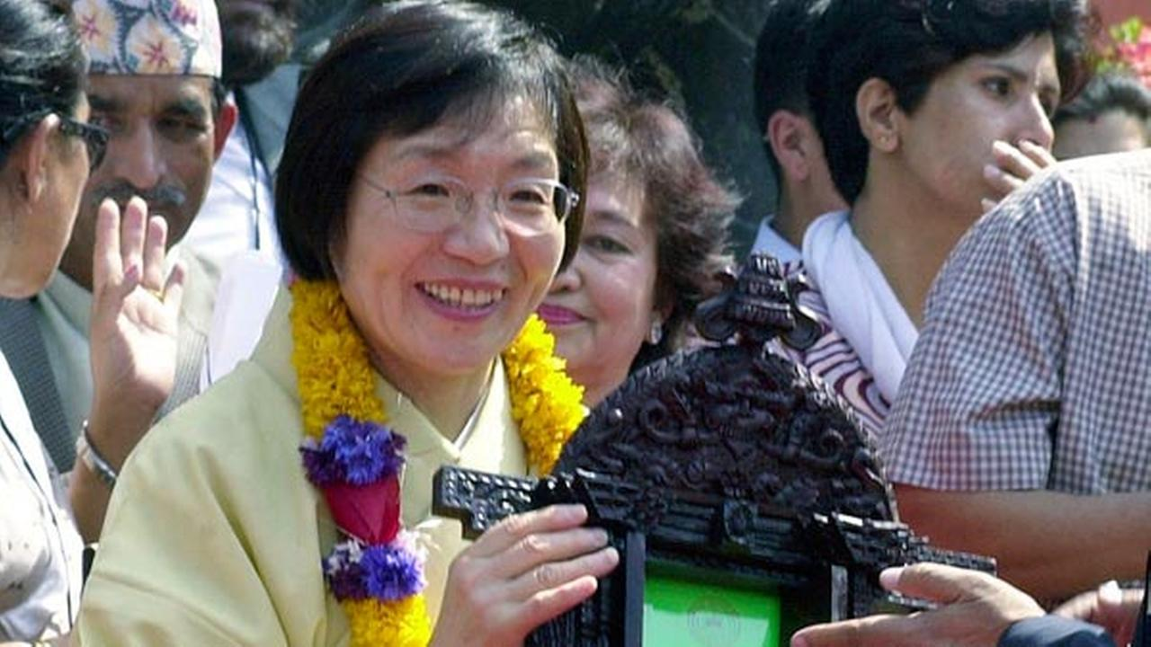 FILE - In this May 27, 2003, file photo, Junko Tabei, the first woman to summit Mount Everest in 1975, receives a gift from a Kathmandu city official during ceremonies in Kathmandu