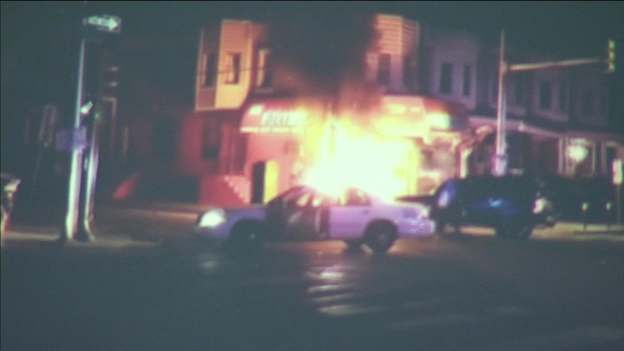 A fiery crash sent two people the hospital and had police knocking on doors to evacuate residents in West Philadelphia.