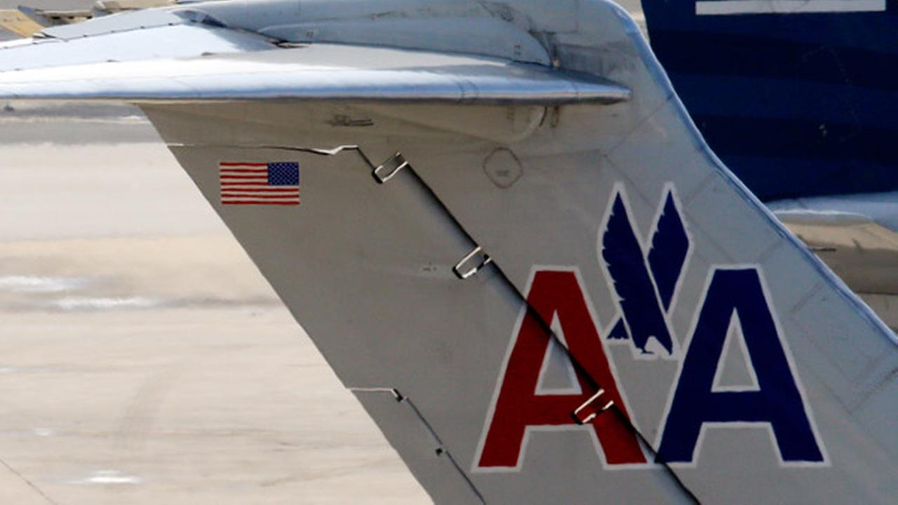 FILE - American Airlines jet prepares for flight at gate at the Philadelphia International Airport, in this Feb. 14, 2013 file photo taken in Philadelphia.
