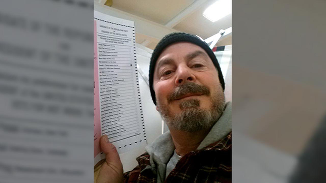In this Feb. 9, 2016, photo, provided by Bill Phillips, of Nashua, N.H., Phillips takes a selfie with his marked election ballot.