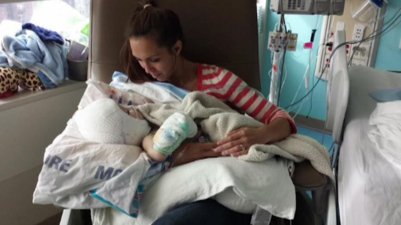 VIDEO: Mom holds separated twin