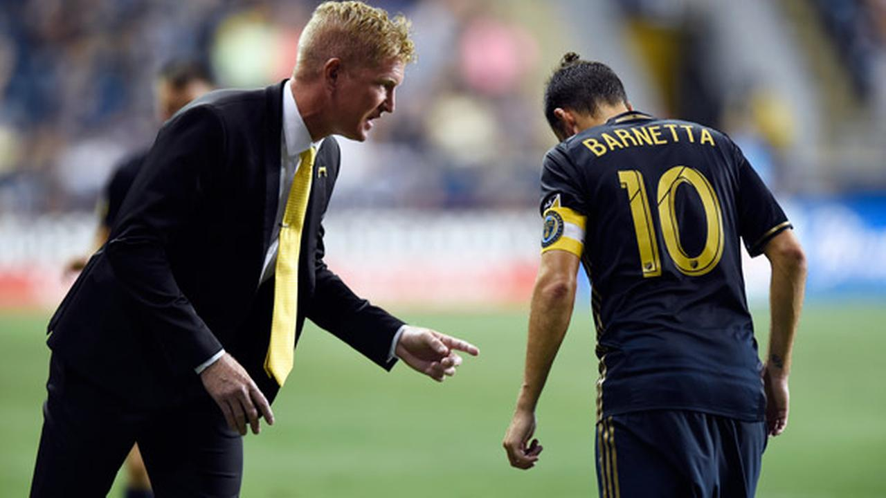Philadelphia Union head coach Jim Curtin talks to Tranquillo Barnetta (10) in the second half of an MLS soccer match on Saturday, Sept. 10, 2016, in Chester, Pa.