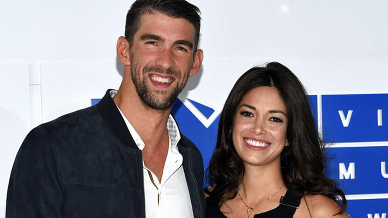 Michael Phelps, left, and Nicole Johnson arrive at the MTV Video Music Awards at Madison Square Garden on Sunday, Aug. 28, 2016, in New York.