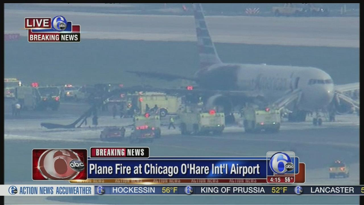 VIDEO: No injuries after plane fire, evacuation at Chicago airport