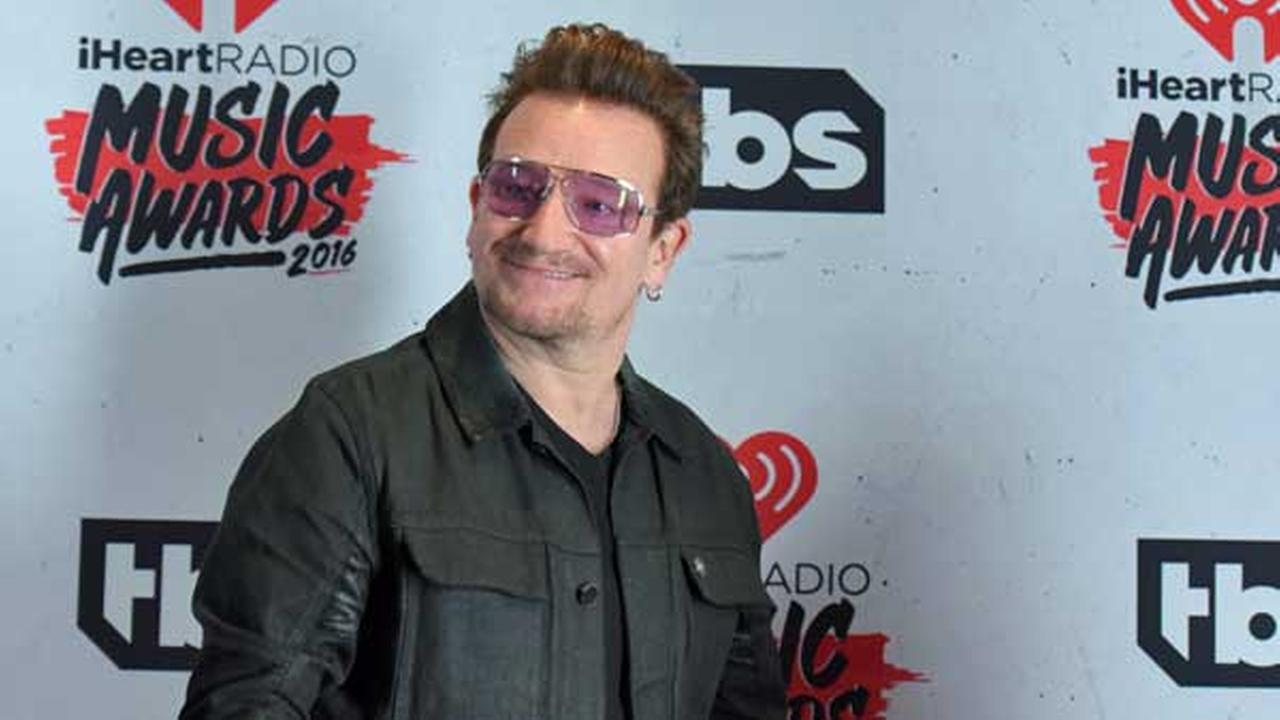 FILE - Bono of U2, winner of the innovator award poses in the press room at the iHeartRadio Music Awards at The Forum on Sunday, April 3, 2016, in Inglewood, Calif.