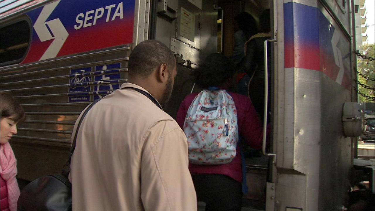 Commuters board a Regional Rail train at the Overbrook Station amid the strike by union SEPTA workers on Tuesday, November 1.