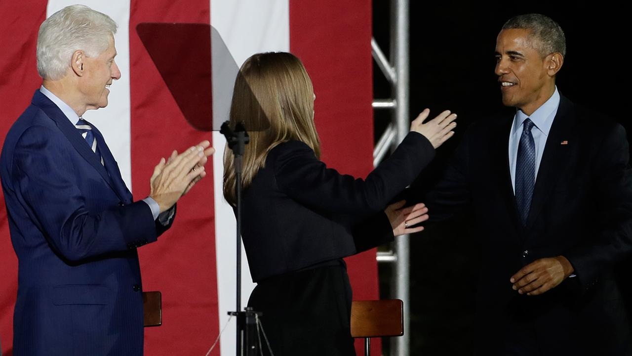 President Barack Obama takes the stage and is applauded by Chelsea Clinton and former President Bill Clinton during a Hillary Clinton campaign event at Independence Mall on Monday.