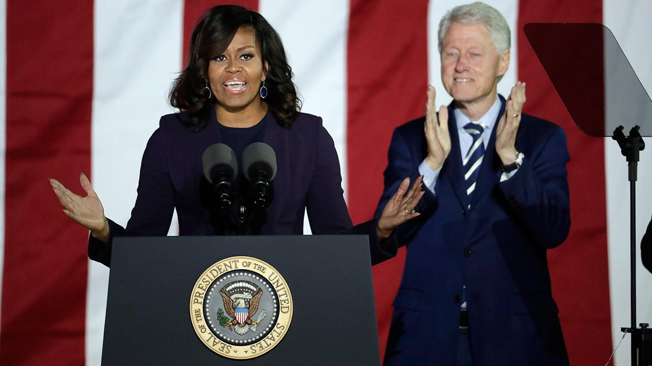 First lady Michelle Obama speaks alongside former President Bill Clinton during a Hillary Clinton campaign event at Independence Mall on Monday, Nov. 7, 2016 in Philadelphia.