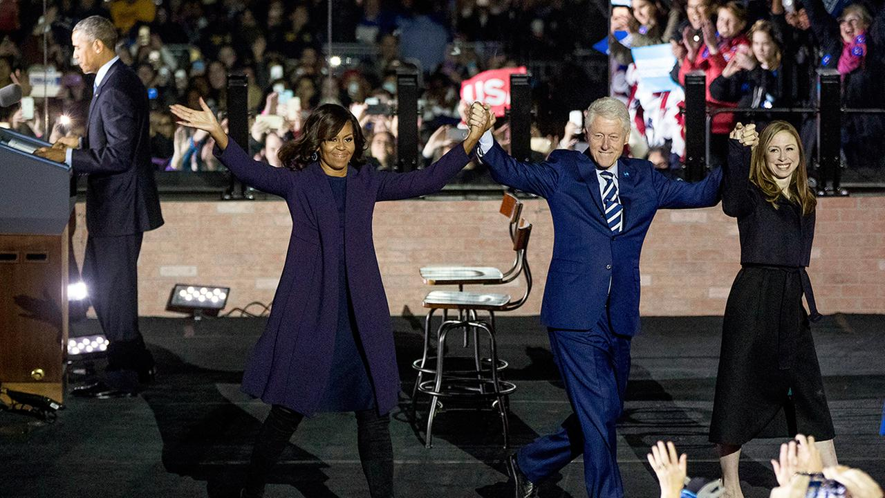 First lady Michelle Obama, former President Bill Clinton and his daughter Chelsea exit the stage after introducing President Barack Obama during a rally for Hillary Clinton.