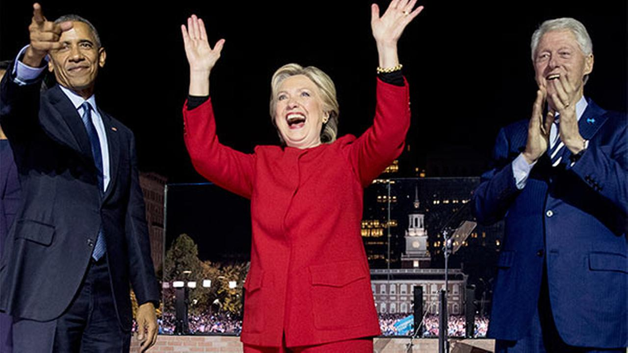 Presidential candidate Hillary Clinton, center, is joined on stage by President Barack Obama and former President Bill Clinton after speaking at a rally on Independence Mall.