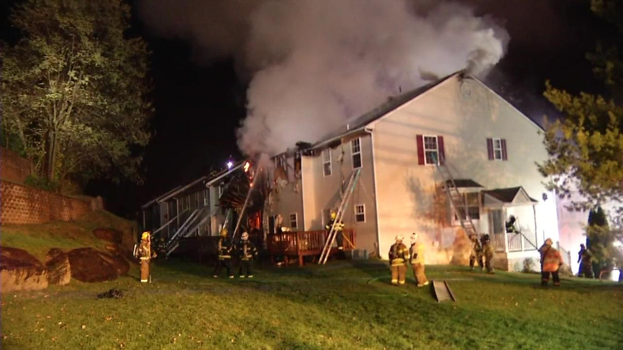 November 16, 2016 - A two-alarm fire damaged four townhouses and injured a firefighter in Aston, Delaware County.