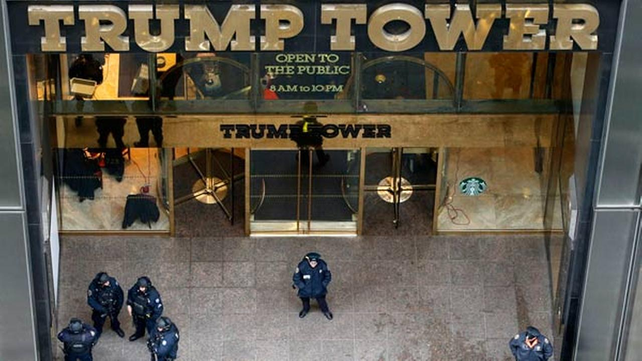 Police stand outside the Fifth Avenue, public, entrance to Trump Tower, Tuesday, Nov. 15, 2016, in New York.