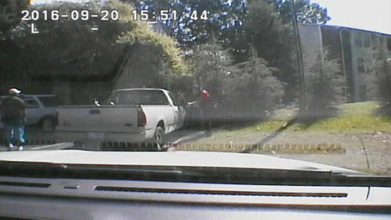 his image made from video provided by the Charlotte-Mecklenburg Police Department shows Keith Scott, left, moments before he was fatally shot by police in Charlotte, N.C.