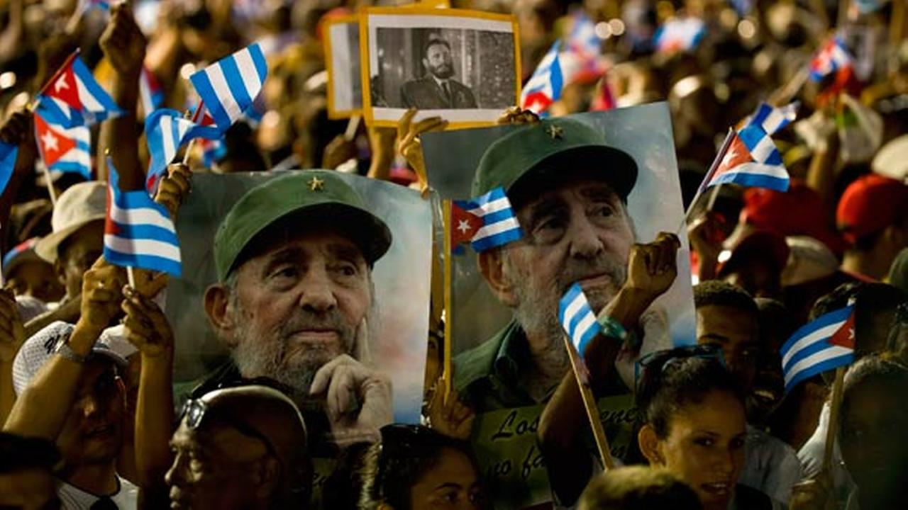 People wait for the start of a memorial honoring the late Fidel Castro at Plaza Antonio Maceo in Santiago, Cuba, Saturday, Dec. 3, 2016.