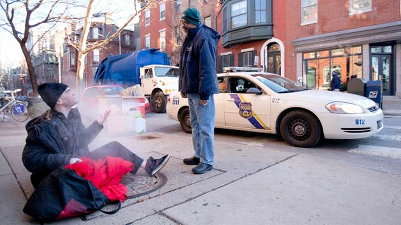 FILE: Project H.O.M.E. Outreach Response Worker Sam Santiago encourages Carl, a homeless man, to come in out of the cold, Tuesday, Jan. 7, 2014, in Philadelphia.