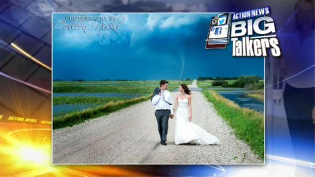 VIDEO: Newlyweds pose in front of tornado