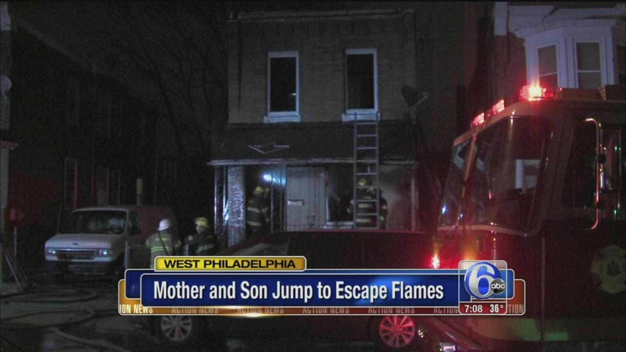 Mother, child jump from burning home