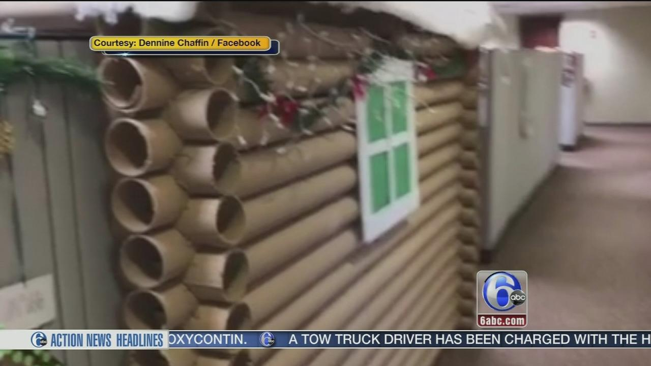 Montco employee transforms cubicle into festive log cabin