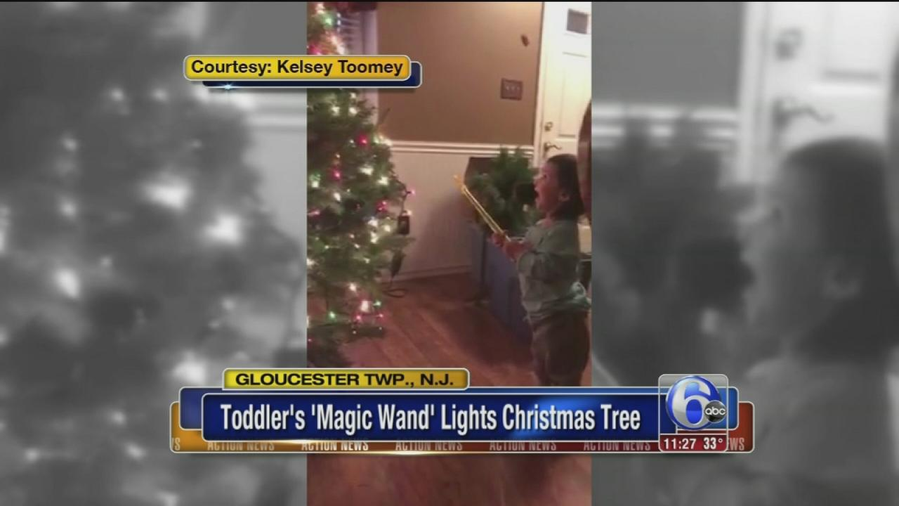 Toddlers magic wand lights Christmas tree