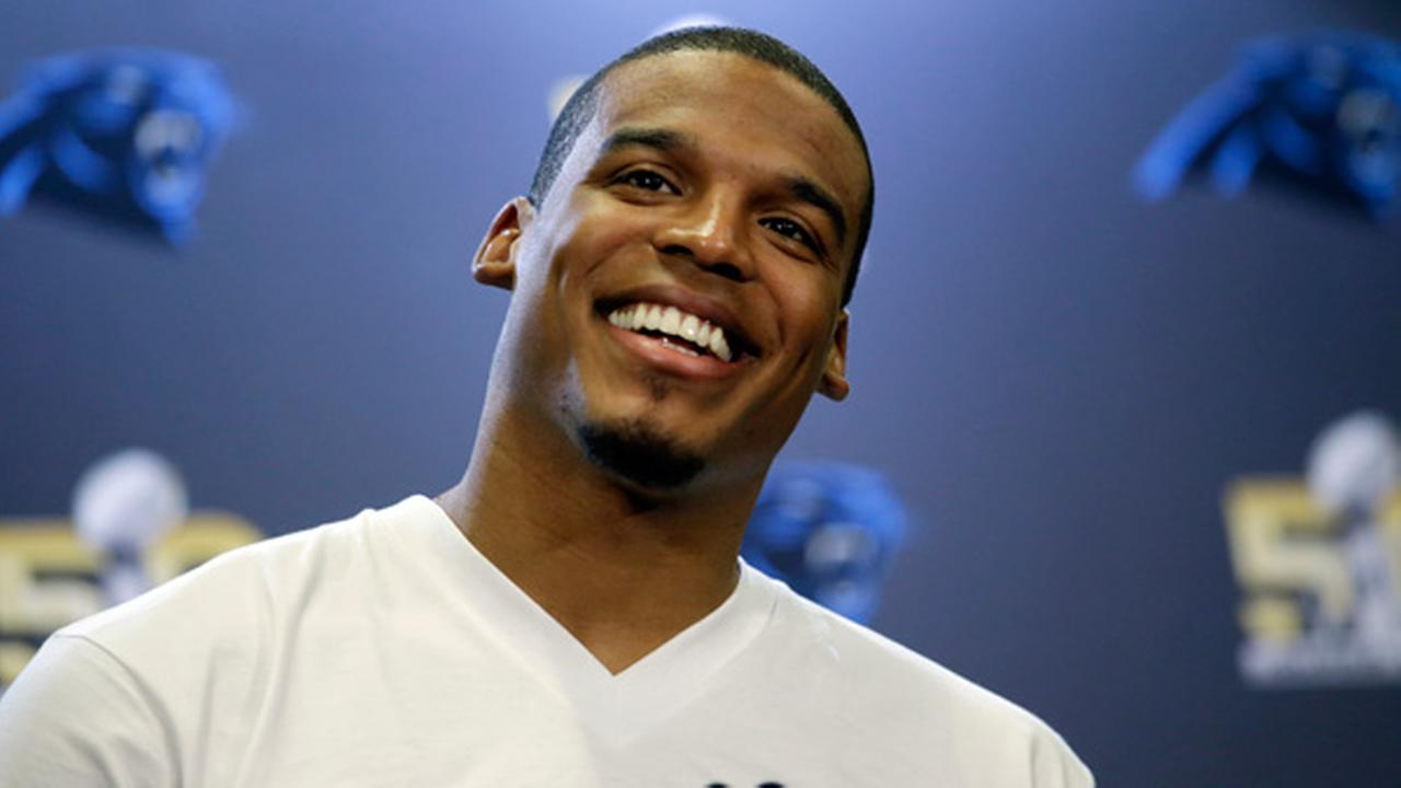 Carolina Panthers quarterback Cam Newton smiles as he answers questions during a press conference Tuesday, Feb. 2, 2016 in San Jose, Calif.
