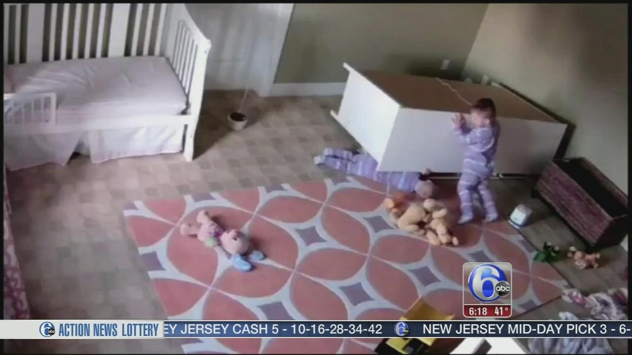 Toddler saves twin under fallen dresser