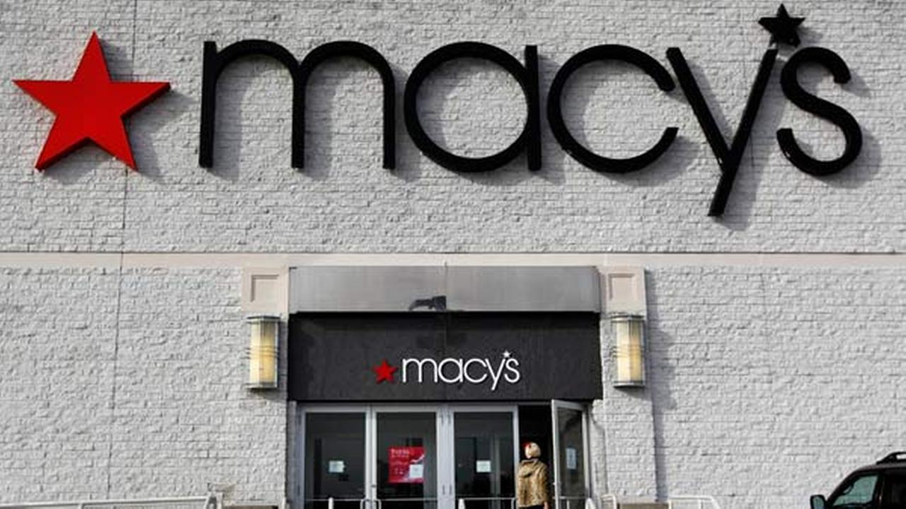 FILE - In this Nov. 3, 2011, file photo, a person enters a Macys department store.