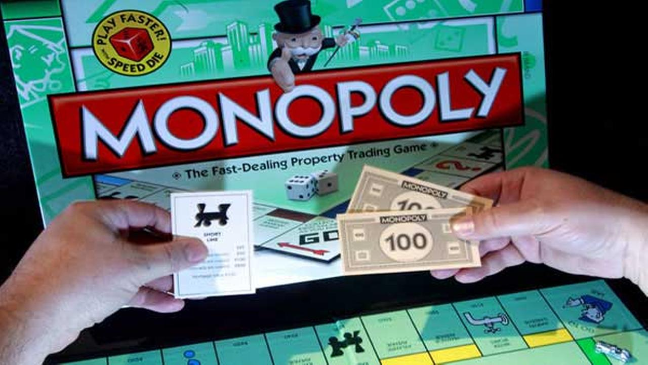 FILE - In this April 13, 2011 file photo, a Monopoly: Fast Dealing Property Trading game is shown, in Portland, Ore.