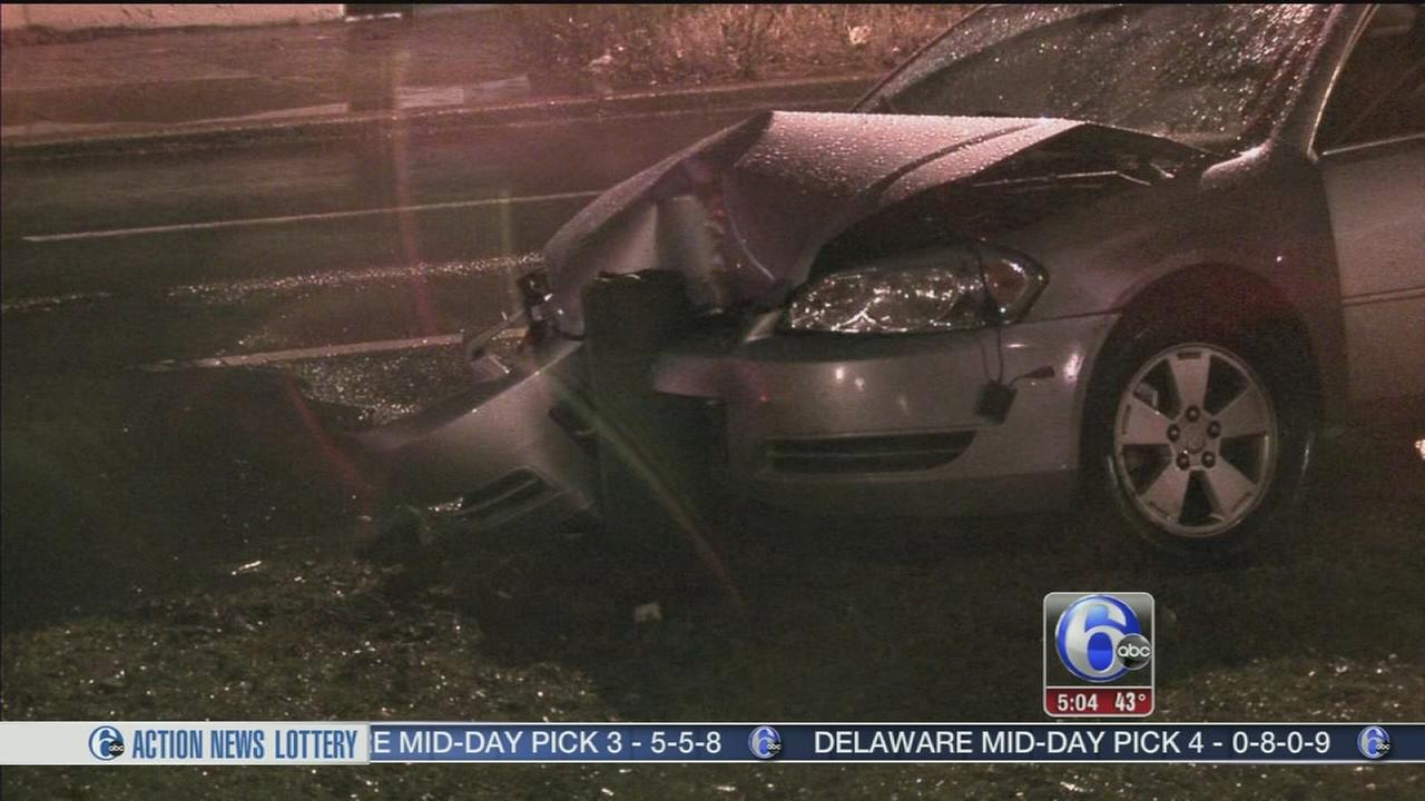 Wet roads cause a car to crash in Feltonville
