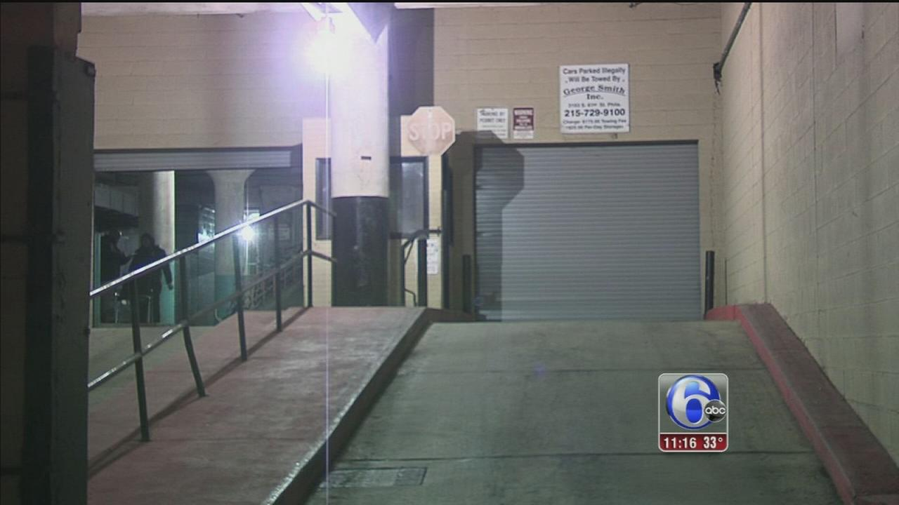 2 sought after woman robbed at gunpoint in South Philly garage
