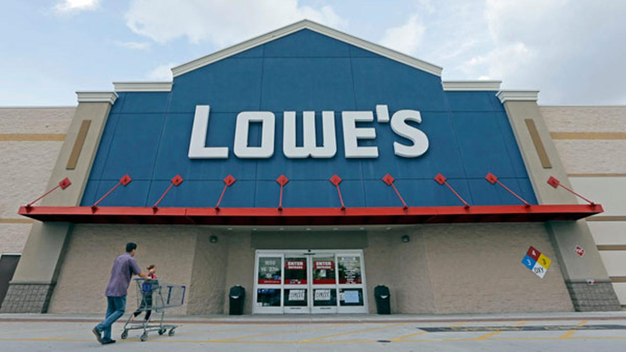 FILE - In this June 29, 2016, file photo, customers walk toward a Lowes store in Hialeah, Fla.