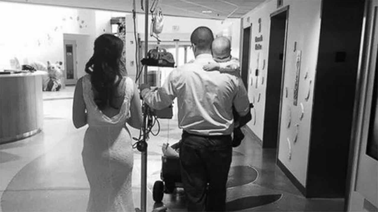 Newlywed parents carry son battling cancer after hospital wedding
